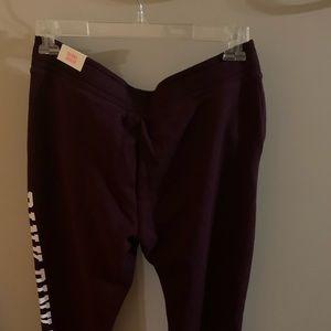 Pink branded sweatpants.